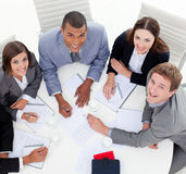 Business team sitting around a conference Stock Images