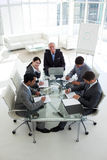 Business team sitting around a conference table Royalty Free Stock Images