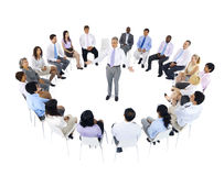 Business Team Sitting around the Leader Royalty Free Stock Image