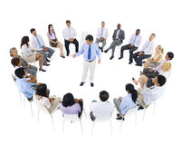 Business Team Sitting around the Leader Stock Photography