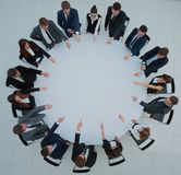 Top view of smilimg business team, sitting at a round table on w Stock Photos