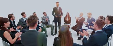 Leader conducts training with business team before you start bra. Business team sitting on chairs arranged in a circle, greet the leader who conducted the Royalty Free Stock Images