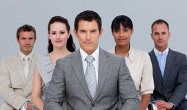 Business team sitting in front of the camera Royalty Free Stock Photography