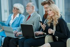 Business team sitting in a row stock photography