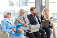 Business team sitting in a row stock image