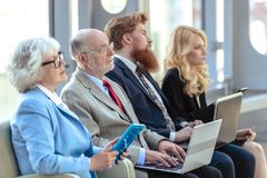 Business team sitting in a row royalty free stock image