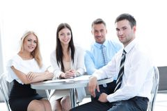 Business team sitting at a table in a cafe. Royalty Free Stock Photography