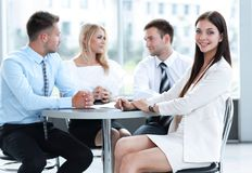 Business team sitting at a table in a cafe, on a work break Stock Photography