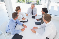 Business team sitting together around the table Stock Photography