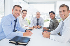 Business team sitting together around the table Stock Image