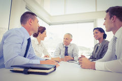 Business team sitting together around the table Royalty Free Stock Photos