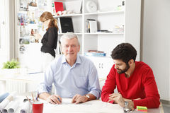 Business team in small architect studio Royalty Free Stock Image