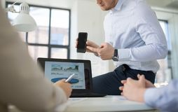 Business team with smartphone working at office royalty free stock photos