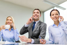 Business team with smartphones having conversation Royalty Free Stock Image