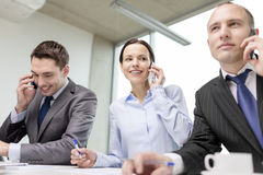 Business team with smartphones having conversation Royalty Free Stock Photography