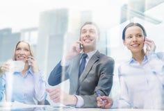 Business team with smartphones having conversation Stock Photos