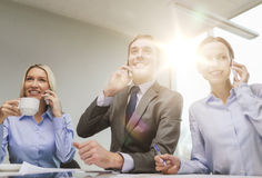 Business team with smartphones having conversation Royalty Free Stock Images