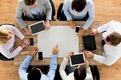 Business team with smartphones and tablet pc Stock Photography