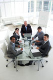 Business team smiling at the camera Royalty Free Stock Photos