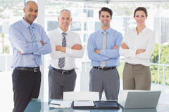 Business team smiling at camera arms crossed Royalty Free Stock Images