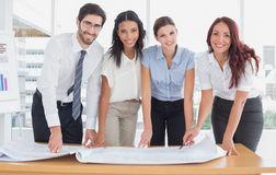 Business team smiling at camera Royalty Free Stock Photos