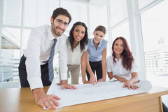 Business team smiling at camera Stock Image