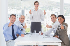 Business team smiling at camera showing thumbs up Royalty Free Stock Photography