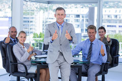 Business team smiling at camera showing thumbs up Royalty Free Stock Photos