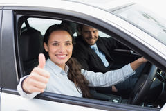 Business team smiling and driving Royalty Free Stock Photos