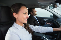 Business team smiling and driving royalty free stock photography