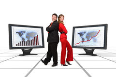 Business team smiling - Financial growth display. Smiling business team standing among two big 3d rendered monitors displaying financial growth Stock Images