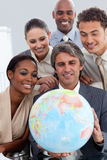 Business team smiling at global business expansion Stock Photo