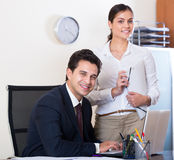 Business team smiling  in office Stock Photography