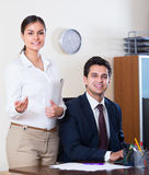Business team smiling  in office. Successful business team 25s smiling and posing in office Stock Photography