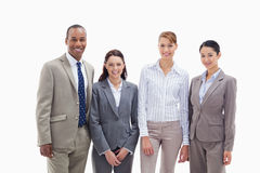 Business team smiling side by side. Against white background Royalty Free Stock Images
