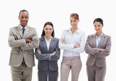 A business team smiling side by side. Close-up of a business team smiling side by side and crossing their arms against white background Royalty Free Stock Photo