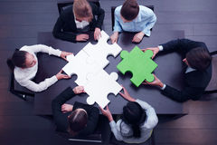 Business team solving puzzle. Concept royalty free stock image