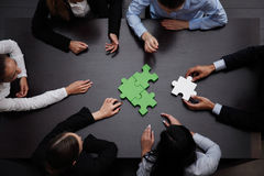 Business team solving puzzle. Together Stock Photo