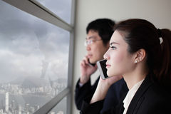 Business team speaking phone Stock Photo