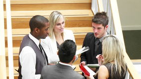 Business team speaking about work in stairs footage Royalty Free Stock Photo