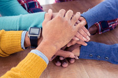 Business team with stacked hands on desk Stock Images