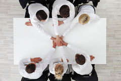 Business team stacking hands Royalty Free Stock Image