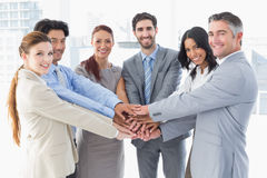 Business team stacking their hands Stock Image
