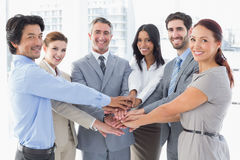 Business team stacking their hands Royalty Free Stock Photo