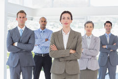 Business team standing arms crossed. In the office Royalty Free Stock Photo