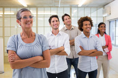 Business team standing with arms folded Stock Photo