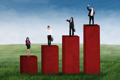 Business team standing on business chart Stock Photography