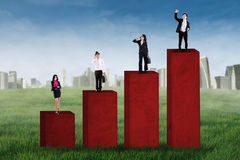 Business team standing on business chart 1 Royalty Free Stock Images