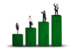Business team standing on business graph Stock Photo