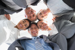 Business team standing in circle Stock Photos
